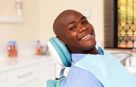 Man smiles at his DeLand implant dentist