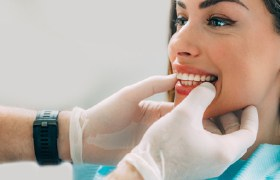 Close-up of dentist evaluating mouth