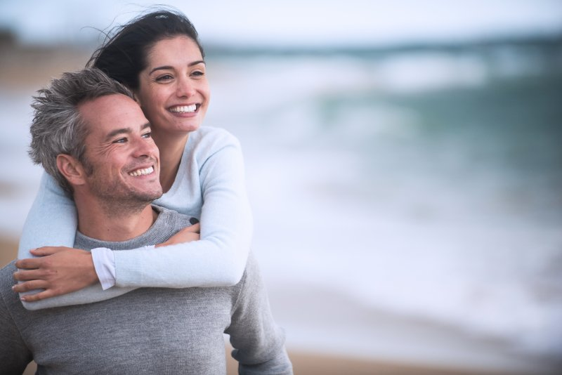 Older couple smiling after using tax refund on their smile